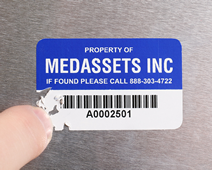 Tamperproof asset label breaks into small pieces