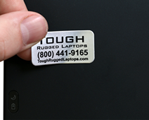 Tough metal asset tags for heavily used laptops