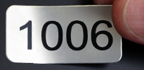 Metal tags with consecutive numbers
